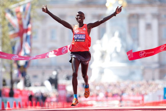 Wilson Kipsang of Kenya crosses the line to win the men's race in the 2014 London Marathon on The Mall in central London on April 13, 2014.    Kenya's world record-holder Wilson Kipsang won the men's London Marathon in a new unofficial course record of two hours, four minutes and 27 seconds.  AFP PHOTO / LEON NEALLEON NEAL/AFP/Getty Images